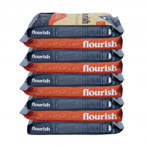 Stacked bags of Flourish dog food