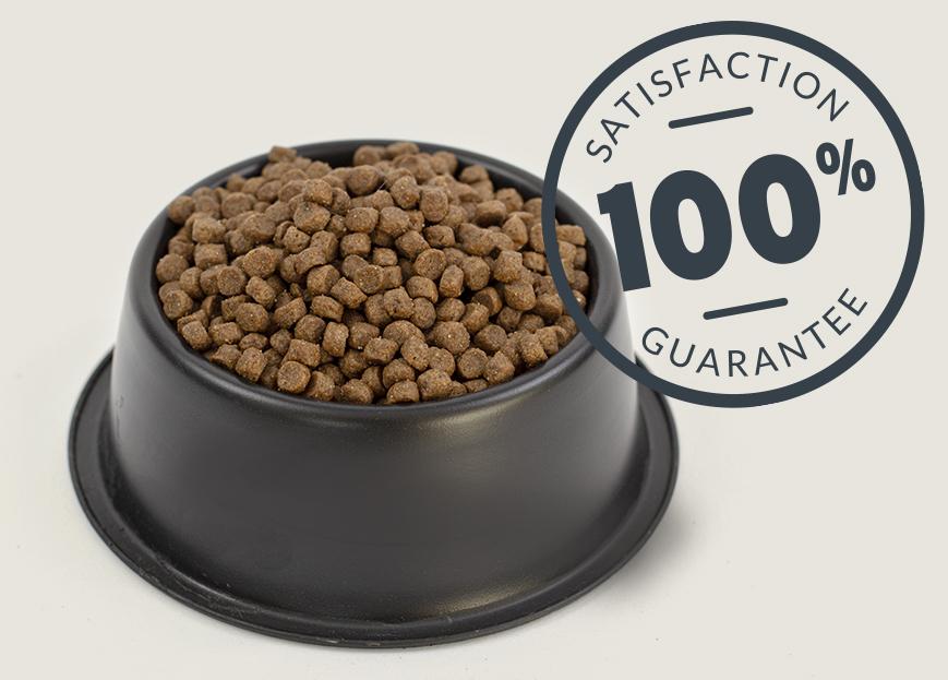 Flourish dog food kibble in dish with 100% satisfaction guarantee seal.